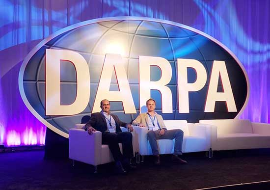 E.B. and John on stage at the DARPA conference