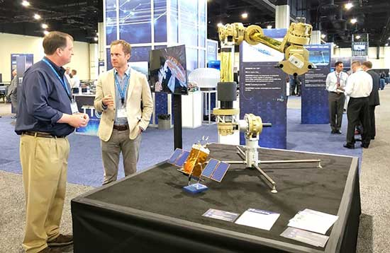 E.B. learning about a solar-powered, robotic, satellite-repair vessel