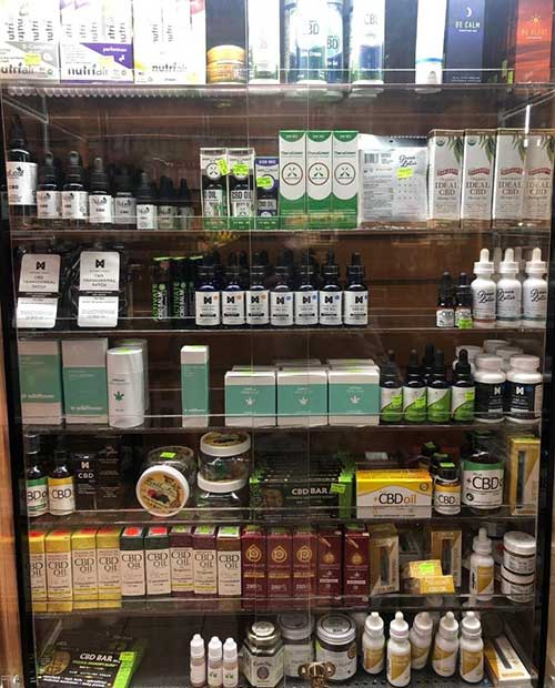 A shelf stocked with CBD products in a Manhattan store